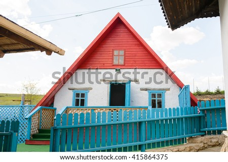 village small house with blue fence