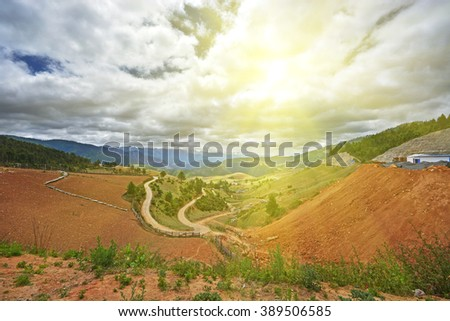 village under mountain and sky