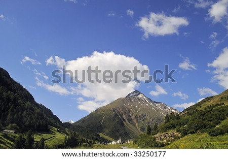 Village Vent with Talleitspitze - highest mountain in the Alps - stock photo