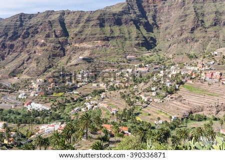 Villages and small towns in the Valle Gran Rey on la Gomera. Terraced fields and date palms is a typical landscape for the Valle Gran Rey, the beautiful canyon on the Canary island La Gomera - stock photo
