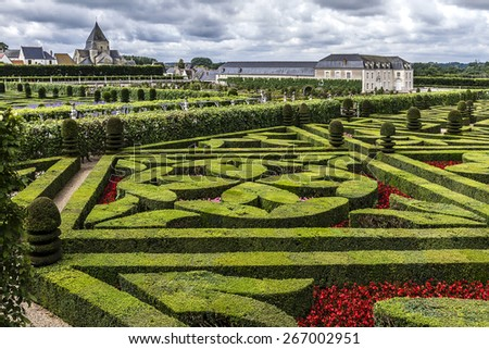 VILLANDRY, FRANCE - JULY 20, 2012: Traditional French garden in Chateau de Villandry. Chateau de Villandry (castle-palace) - world known for its amazing gardens. - stock photo