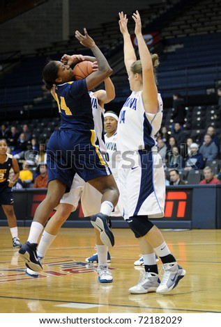 VILLANOVA, PA - DECEMBER 9: West Virginia University women's basketball player Madina Ali (L) battles for control of the ball in traffic early in a game on December 9, 2010 in Villanova, PA.