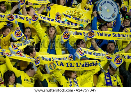 VILLARREAL, SPAIN - APR 28: Fans at the Europa League semifinal match between Villarreal CF and Liverpool FC at the El Madrigal Stadium on April 28, 2016 in Villarreal, Spain. - stock photo