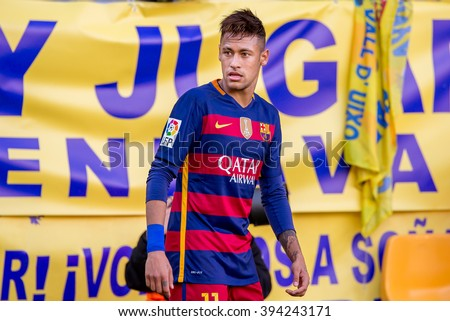 VILLARREAL, SPAIN - MAR 20: Neymar plays at the La Liga match between Villarreal CF and FC Barcelona at El Madrigal Stadium on March 20, 2016 in Villarreal, Spain. - stock photo