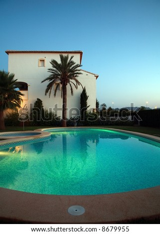 Villas with swimming pool by night