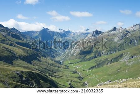 VILLE DES GLACIERS, FRANCE - AUGUST 27: Ville des Glaciers with Les Chapieux in the background. The region is a stage at the popular Mont Blanc tour. August 27, 2014 in Ville des Glaciers. - stock photo