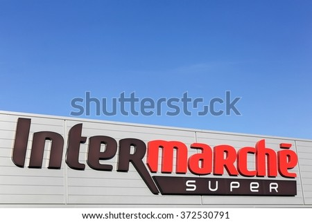 Villefranche, France - January 24, 2016: Intermarche logo on a facade. Intermarche is the brand of a general commercial french supermarket, part of the large retail group Les Mousquetaires.