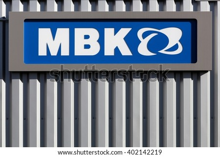 Villefranche, France - March 27, 2016: MBK logo on a wall. MBK a subsidiary of Yamaha Motor Company, is a french scooter manufacturer, based in Rouvroy, France