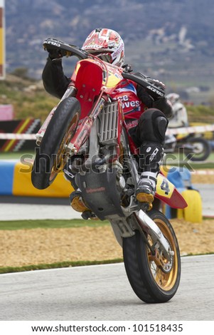 VILLENA, SPAIN - MAY 29: Anthony Ford Dunn pulls a wheelie at in the Spanish championship of supermotard on May 29, 2012, Villena Spain - stock photo