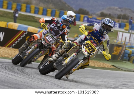 VILLENA, SPAIN - MAY 29: Riders of motorcycling in the Spanish championship of supermotard on May 29, 2012, Villena Spain - stock photo
