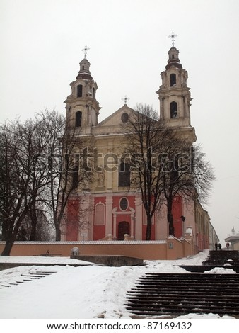 Vilnius archangel church on the board river Neris. - stock photo