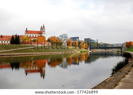 Vilnius archangel church on the board river Neris. Lithuania. - stock photo