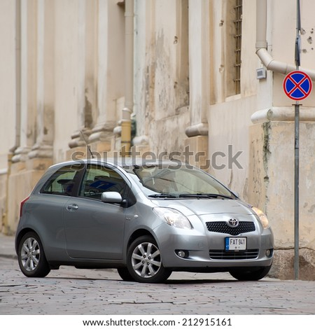 VILNIUS - AUG 9: Toyota Yaris in Vilnius old town on Aug. 9, 2014 in Vilnius, Lithuania. The Toyota Yaris is a subcompact car produced by Toyota since 1999, replacing the Toyota Starlet. - stock photo