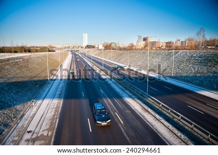 VILNIUS - DECEMBER 26: Highway (motorway) traffic on December 26, 2014 in Vilnius, Lithuania. A newly constructed street connect IXB transport corridor with Vilnius International Airport. - stock photo