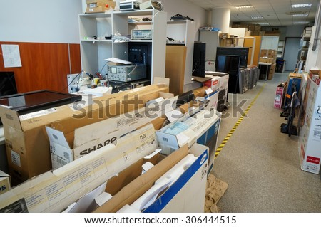 VILNIUS, LITHUANIA - AUGUST 14, 2015: Working room of Lithuanian service   repair of TVs and consumer electronics. Repair all known brands is provided - Panasonic, Sharp, Philips, Samsung and so on. - stock photo