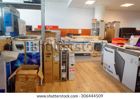 VILNIUS, LITHUANIA - AUGUST 14, 2015: Working room of  small center for repair of TVs and consumer electronics. Repair of all known brands is provided - Panasonic, Philips, Samsung and so on. - stock photo