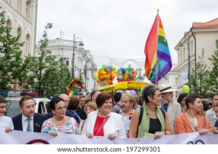 VILNIUS, LITHUANIA - JULY 27: Famous politics people in beginning of gay parade crowd members on July 27, 2013 in Vilnius. Fight for gay and lesbian equality rights.  - stock photo