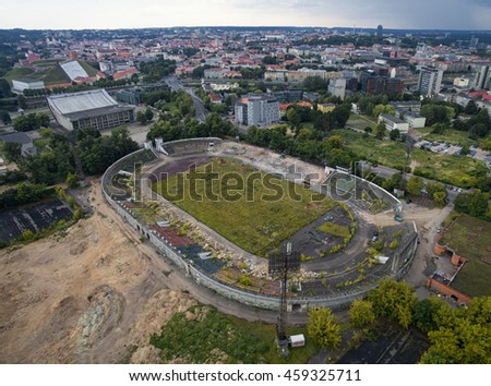 VILNIUS, LITHUANIA - JULY 11, 2016: Flying over the Vilnius and Zalgiris Stadium in Background. Gediminas Tower and Oldtown In Background