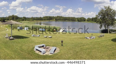 VILNIUS, LITHUANIA - JULY 02, 2016: Summer rest  zone with  grass beach near lake on Lavender Village in Kiemeliu rural area. It is the first Lithuanian  farm on cultivation a lavender aroma flowers