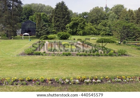 VILNIUS, LITHUANIA - JUNE 17, 2016: Pansies and exotic plants beds in the Botanical Garden of Vilnius University. At the beginning of 18th  century it was the residence and estate governor of Vilnius - stock photo