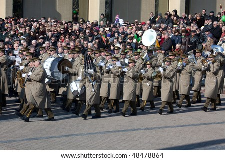 VILNIUS, LITHUANIA - MARCH 11:  People watching brass parade during ceremony of hoisting flags on 20th Anniversary of Restoration of Independence of Lithuania on Mar 11, 2010 in Vilnius, Lithuania.