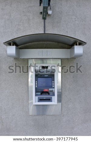 VILNIUS, LITHUANIA - MARCH 27, 2016: The street ATM of production of Diebold brand is built in a wall of SEB bank. Diebold and IBM created a general partnership called InterBold in 1991 - stock photo