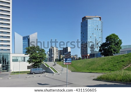 "VILNIUS, LITHUANIA - MAY 29, 2016: Column with arrows with the name of all  streets on Constitution Avenue. On a background - the building of big shopping center ""Europe"" and ""Swedbank"""