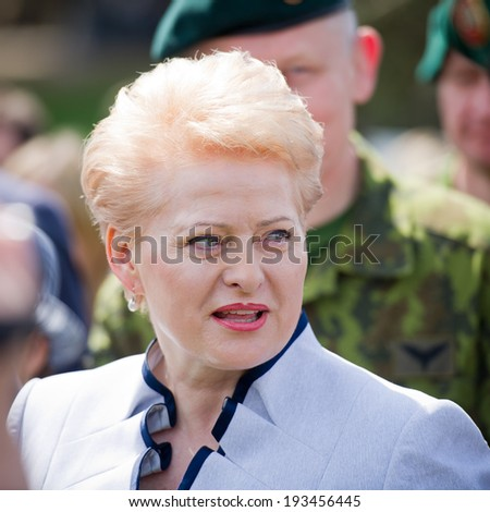 VILNIUS, LITHUANIA - MAY 17: The President of Lithuania Dalia Grybauskaite visiting Public and Military Day Festival held by the White Bridge on May 17, 2014 in Vilnius, Lithuania.