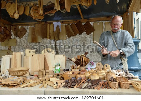 VILNIUS, LITHUANIA - MAY 24 : Unidentified people carve wood in the street during a International Folklore Festival on May 24 2013 in Vilnius, Lithuania.