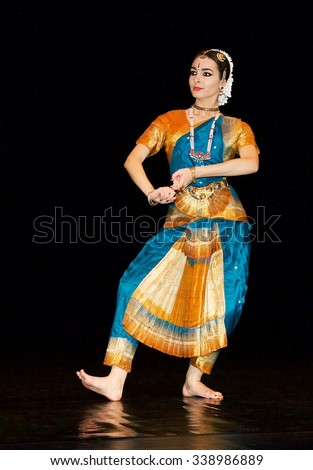 VILNIUS, LITHUANIA - Nov 7: girl from folk music group presenting traditional indian costumes in Vilnius on Nov 7,2015.Traditional indian costume and hair Jewelery of indian woman, indian colors - stock photo