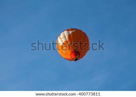 VILNIUS, LUTHUANIA - 22 AUG 2015: Red Hot Air Balloon in the air under city - stock photo