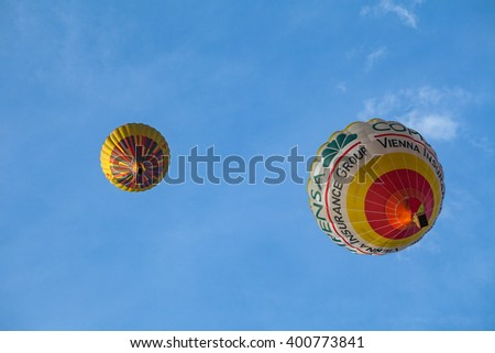 VILNIUS, LUTHUANIA - 22 AUG 2015: Two yellow Hot Air Balloon in the air under city - stock photo