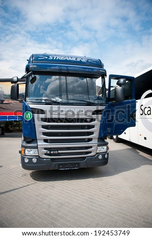 VILNIUS-MAY 9: Scania R410 SCR Streamline Truck on May 9, 2014 in Vilnius, Lithuania. Scania is a major Swedish automotive manufacturer of commercial vehicles - specifically heavy trucks and buses. - stock photo
