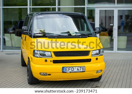 VILNIUS-MAY 9: VW Transporter/Multivan/Caravelle T4 tuning van on May 9, 2014 in Vilnius, Lithuania. The Volkswagen Transporter refers to a series of vans produced over 60 years and marketed worldwide - stock photo