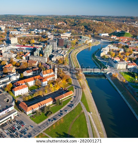 VILNIUS-OCT 18: Aerial View of Vilnius Old Town, river Neris on Oct. 18, 2014 in Vilnius, Lithuania. Vilnius is known for its Old Town of beautiful architecture, declared a UNESCO World Heritage Site. - stock photo