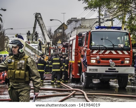 VINA DEL MAR, CHILE - AUG 21: Burning down of 20 commercial stands in the middle of the city on August 21, 2010 in Vina del Mar, Chile. - stock photo