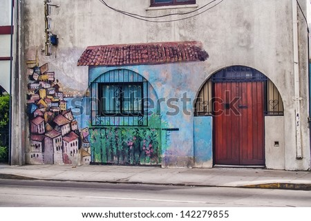 VINA DEL MAR, FEBRUARY 12: Graffiti representing the neightbour city of Valparaiso in a house on February 12, 2011 in Vina del Mar, Chile. - stock photo