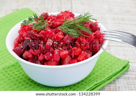 Vinaigrette salad with dill. On the table with fork and green napkin. - stock photo
