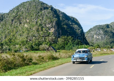 Vinales, Cuba - 25 January 2016: people conducting a vintage car in the valley of Vinales on Cuba