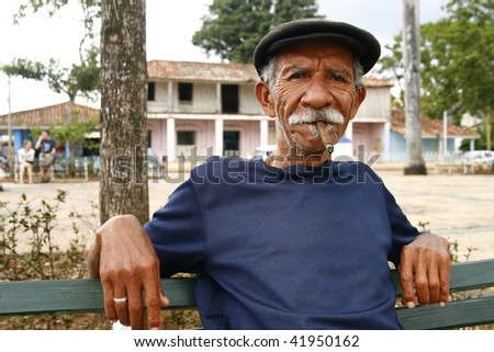 VINALES, CUBA - MARCH 19: Cuban man smoking a cigar on March 19, 2009 in Vinales, Cuba. Cubans of all ages are actively smoking cigars. All the production in Cuba is controlled by the Cuban government. - stock photo