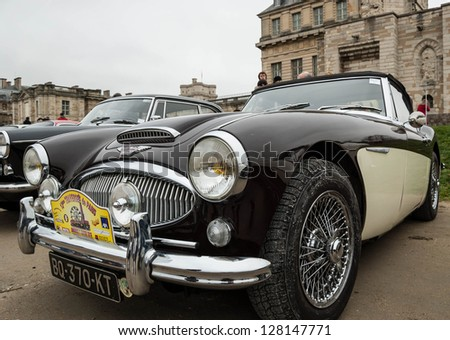 VINCENNES, FRANCE - JANUARY 6: Austin Healey 3000 MkIII  takes part in antique cars exhibition on January 6, 2013 in Vincennes, France. - stock photo