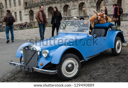 VINCENNES, FRANCE - JANUARY 6: Georges Irat car with funny elk toy takes part in antique cars exhibition on January 6, 2013 in Vincennes, France. - stock photo