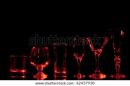 vine glass group on red light - stock photo