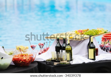 vine salad cheese and other food on buffet party outdoor - stock photo