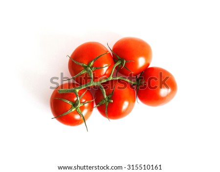 Vine tomatoes isolated top view - stock photo