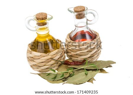 Vinegar, oil and laurel - stock photo