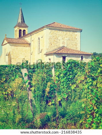 Vineyard on the Background of Church in France, Instagram Effect - stock photo
