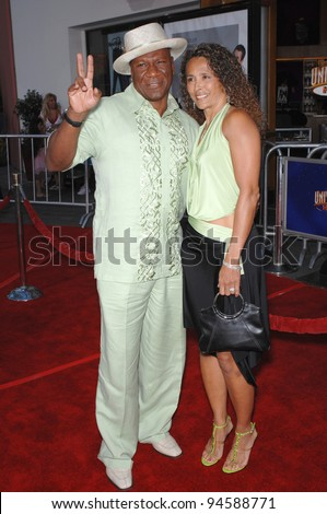 "Ving Rhames & wife at the world premiere of ""I Now Pronounce You Chuck and Larry"" at the Gibson Amphitheatre, Universal City. July 13, 2007  Los Angeles, CA Picture: Paul Smith / Featureflash - stock photo"