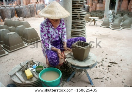 VINH LONG, VIET NAM- JULY 1: Potter form pot at potterry workshop in Vinh Long, Viet Nam on July 1, 2013