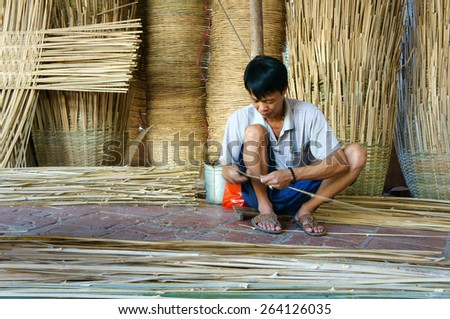 VINH LONG, VIET NAM- MAR 24: Asia trade village at Mekong Delta, Vietnamese people work inside to make basket from bamboo material, clever hand and hard working to make product, Vietnam, Mar 24, 2015